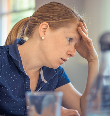 Woman frustrated at work, work sucks
